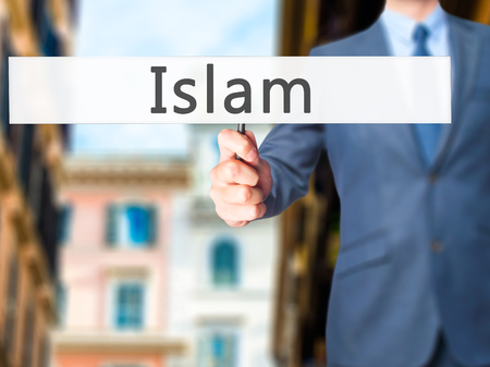morality: Islam - Businessman hand holding sign. Business, technology, internet concept. Stock Photo Stock Photo