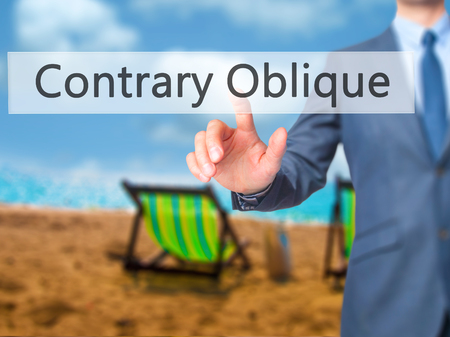 opposites: Contrary - Oblique - Businessman hand pressing button on touch screen interface. Business, technology, internet concept. Stock Photo
