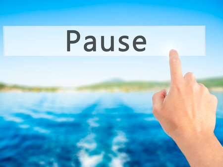 respite: Pause - Hand pressing a button on blurred background concept . Business, technology, internet concept. Stock Photo