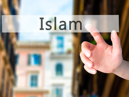 morality: Islam - Hand pressing a button on blurred background concept . Business, technology, internet concept. Stock Photo