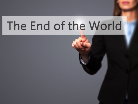 end of world: The End of the World - Businesswoman hand pressing button on touch screen interface. Business, technology, internet concept. Stock Photo