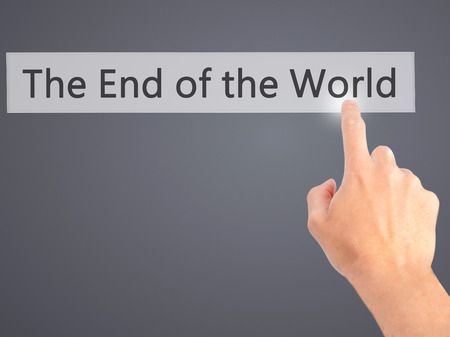 near death: The End of the World - Hand pressing a button on blurred background concept . Business, technology, internet concept. Stock Photo Stock Photo