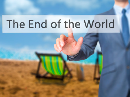 end of world: The End of the World - Businessman hand pressing button on touch screen interface. Business, technology, internet concept. Stock Photo