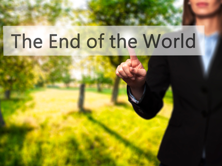 near death: The End of the World - Businesswoman hand pressing button on touch screen interface. Business, technology, internet concept. Stock Photo