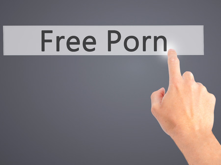 порно: Free Porn - Hand pressing a button on blurred background concept . Business, technology, internet concept. Stock Photo Фото со стока