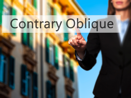 contrary: Contrary - Oblique - Businesswoman hand pressing button on touch screen interface. Business, technology, internet concept. Stock Photo