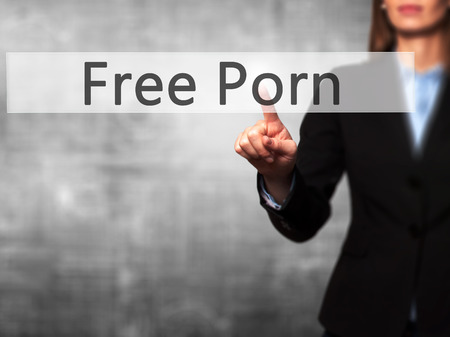 internet porn: Free Porn - Businesswoman hand pressing button on touch screen interface. Business, technology, internet concept. Stock Photo Stock Photo