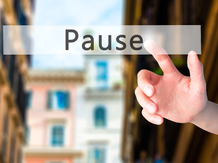 lull: Pause - Hand pressing a button on blurred background concept . Business, technology, internet concept. Stock Photo