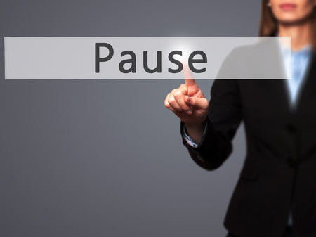 lull: Pause - Businesswoman hand pressing button on touch screen interface. Business, technology, internet concept. Stock Photo