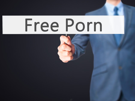 internet porn: Free Porn - Businessman hand holding sign. Business, technology, internet concept. Stock Photo Stock Photo