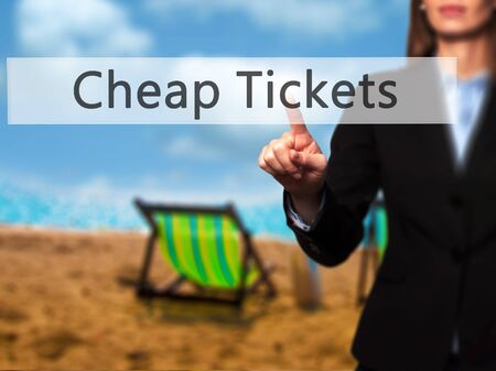 miles: Cheap Tickets - Businesswoman hand pressing button on touch screen interface. Business, technology, internet concept. Stock Photo