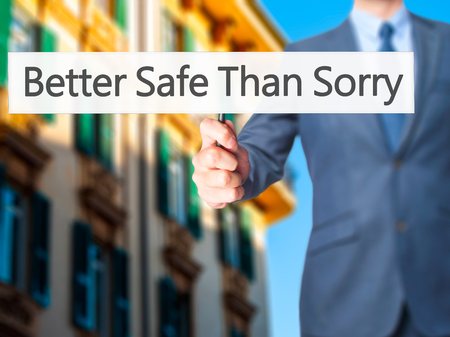 better chances: Better Safe Than Sorry - Businessman hand holding sign. Business, technology, internet concept. Stock Photo