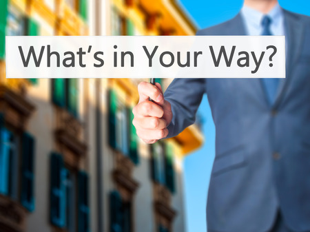 persevere: Whats in Your Way? - Businessman hand holding sign. Business, technology, internet concept. Stock Photo