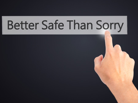 better safe than sorry: Better Safe Than Sorry - Hand pressing a button on blurred background concept . Business, technology, internet concept. Stock Photo