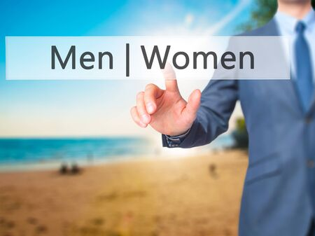 challenging sex: Men Women - Businessman hand pressing button on touch screen interface. Business, technology, internet concept. Stock Photo Stock Photo