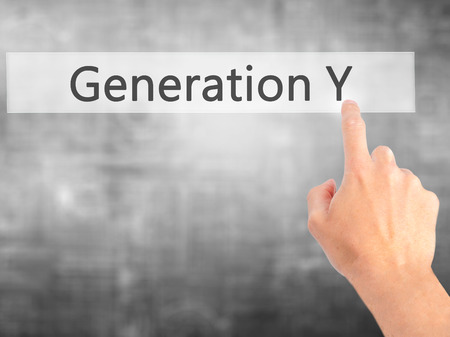 generation y: Generation Y - Hand pressing a button on blurred background concept . Business, technology, internet concept. Stock Photo