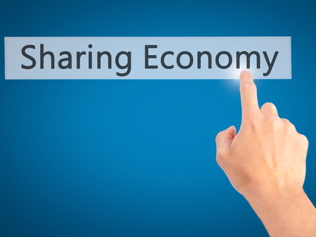 debt goals: Sharing Economy - Hand pressing a button on blurred background concept . Business, technology, internet concept. Stock Photo