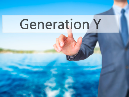 generation y: Generation Y - Businessman hand pressing button on touch screen interface. Business, technology, internet concept. Stock Photo
