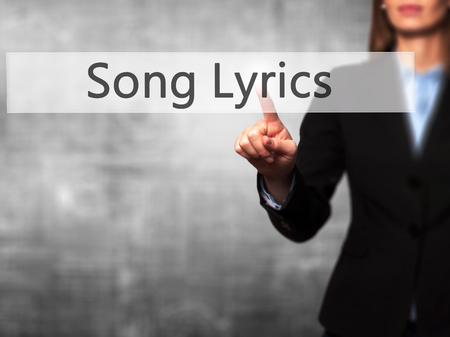 lyrics: Song Lyrics - Businesswoman hand pressing button on touch screen interface. Business, technology, internet concept. Stock Photo Stock Photo