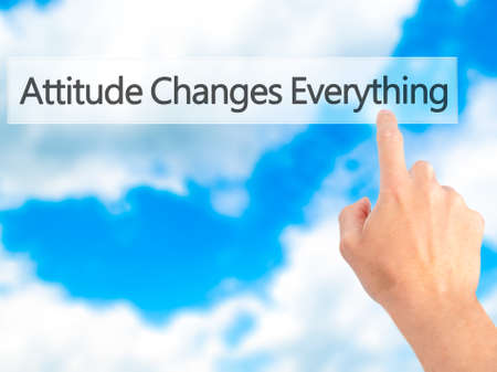 carrer: Attitude Changes Everything - Hand pressing a button on blurred background concept . Business, technology, internet concept. Stock Photo