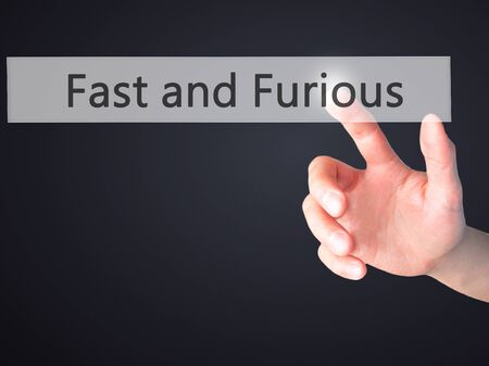 quickness: Fast and Furious - Hand pressing a button on blurred background concept . Business, technology, internet concept. Stock Photo