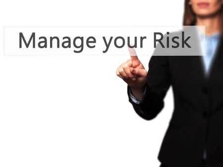 losing control: Manage your Risk - Businesswoman hand pressing button on touch screen interface. Business, technology, internet concept. Stock Photo