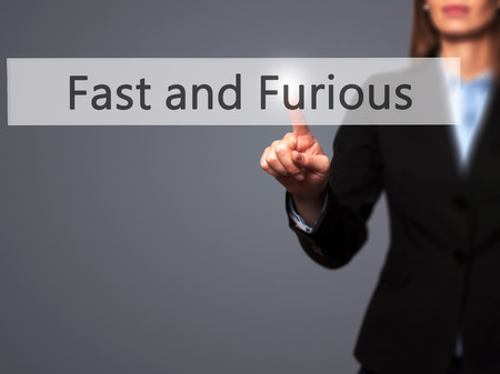 quickness: Fast and Furious - Businesswoman hand pressing button on touch screen interface. Business, technology, internet concept. Stock Photo Stock Photo