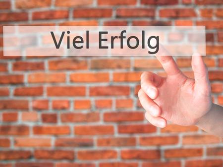 Viel Erfolg  (Much Success In German) - Hand pressing a button on blurred background concept