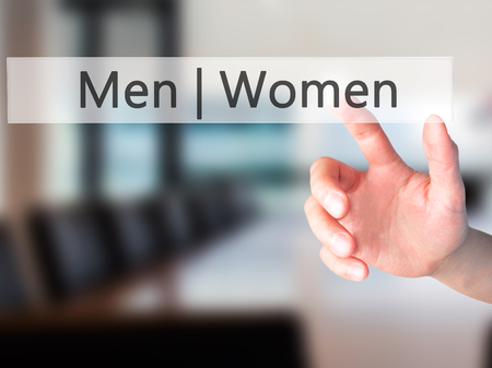 challenging sex: Men Women - Hand pressing a button on blurred background concept