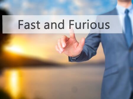 quickness: Fast and Furious - Businessman hand pressing button on touch screen interface. Business, technology, internet concept. Stock Photo Stock Photo