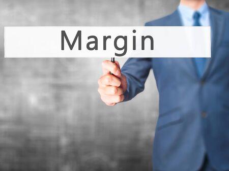 margen: Margin - Businessman hand holding sign.