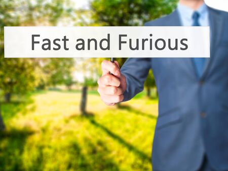quickness: Fast and Furious - Businessman hand holding sign. Business, technology, internet concept. Stock Photo