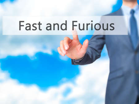 fastness: Fast and Furious - Businessman hand pressing button on touch screen interface. Business, technology, internet concept. Stock Photo Stock Photo