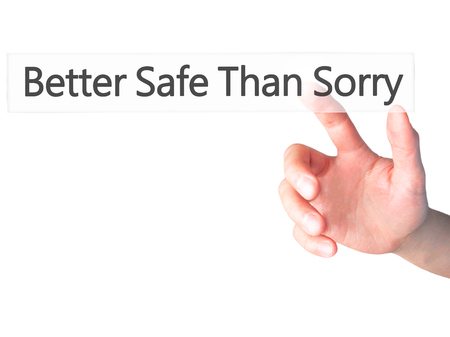 desirable: Better Safe Than Sorry - Hand pressing a button on blurred background concept . Business, technology, internet concept. Stock Photo