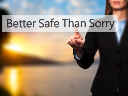 better safe than sorry: Better Safe Than Sorry - Businesswoman hand pressing button on touch screen interface. Business, technology, internet concept. Stock Photo
