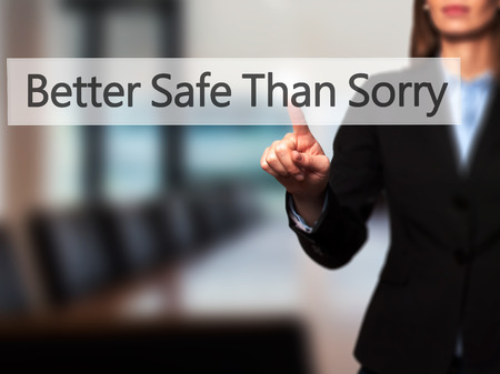 better safe than sorry: Better Safe Than Sorry - Businesswoman hand pressing button on touch screen interface.