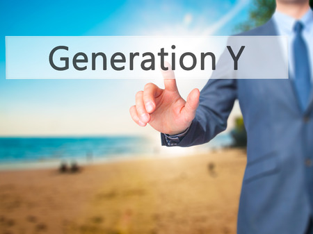generation y: Generation Y - Businessman hand pressing button on touch screen interface.