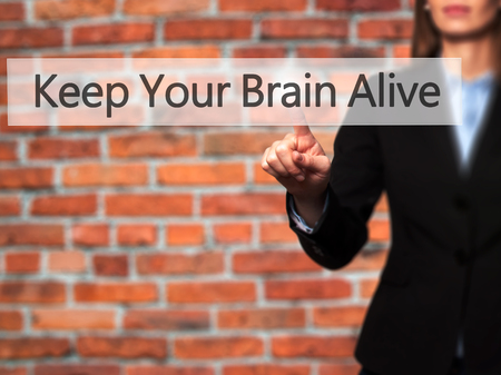 keep in touch: Keep Your Brain Alive - Businesswoman hand pressing button on touch screen interface.