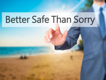 better safe than sorry: Better Safe Than Sorry - Businessman hand pressing button on touch screen interface.