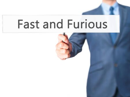 quickness: Fast and Furious - Businessman hand holding sign.