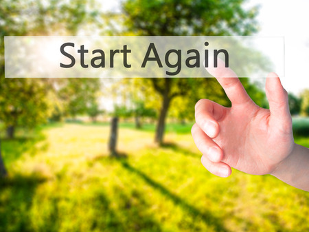 displacement: Start Again - Hand pressing a button on blurred background concept . Business, technology, internet concept. Stock Photo Stock Photo
