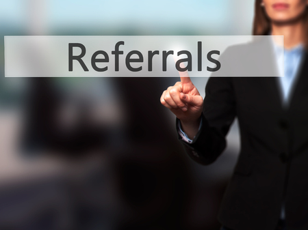 referidos: Referrals - Businesswoman hand pressing button on touch screen interface. Business, technology, internet concept. Stock Photo