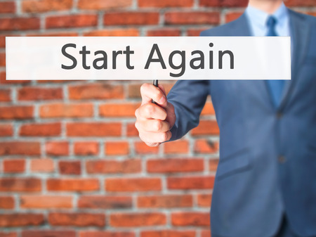 failed plan: Start Again - Businessman hand holding sign. Business, technology, internet concept. Stock Photo