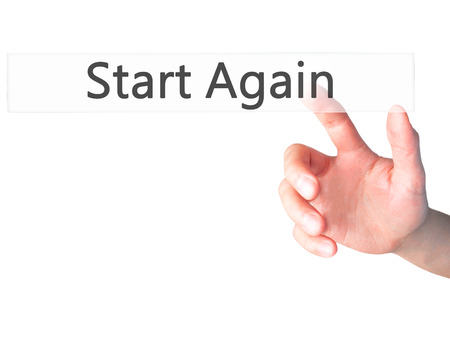 again: Start Again - Hand pressing a button on blurred background concept . Business, technology, internet concept. Stock Photo Stock Photo