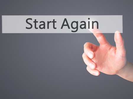 failed strategy: Start Again - Hand pressing a button on blurred background concept . Business, technology, internet concept. Stock Photo Stock Photo