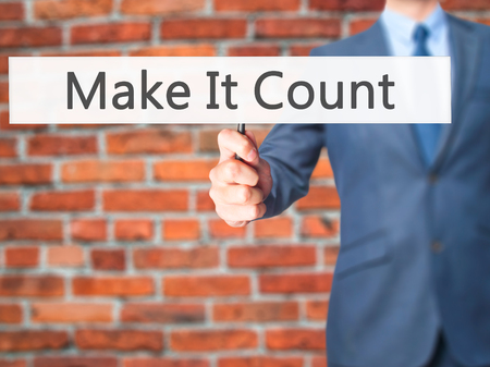 consequence: Make It Count - Businessman hand holding sign. Business, technology, internet concept. Stock Photo Stock Photo