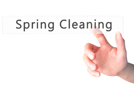 purge: Spring Cleaning - Hand pressing a button on blurred background concept . Business, technology, internet concept. Stock Photo