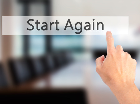 transference: Start Again - Hand pressing a button on blurred background concept . Business, technology, internet concept. Stock Photo Stock Photo