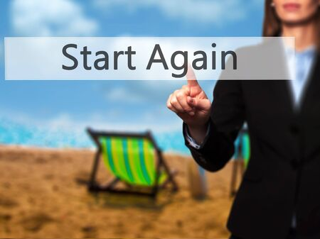 failed plan: Start Again - Businesswoman hand pressing button on touch screen interface. Business, technology, internet concept. Stock Photo