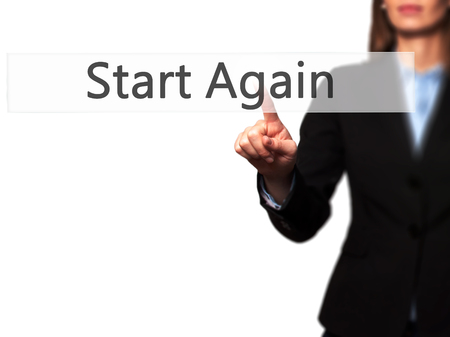 commence: Start Again - Businesswoman hand pressing button on touch screen interface. Business, technology, internet concept. Stock Photo